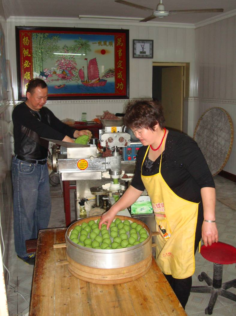 Picture: The owner and his wife work the tuanzi maker.  Yang Shan, Wuxi, China