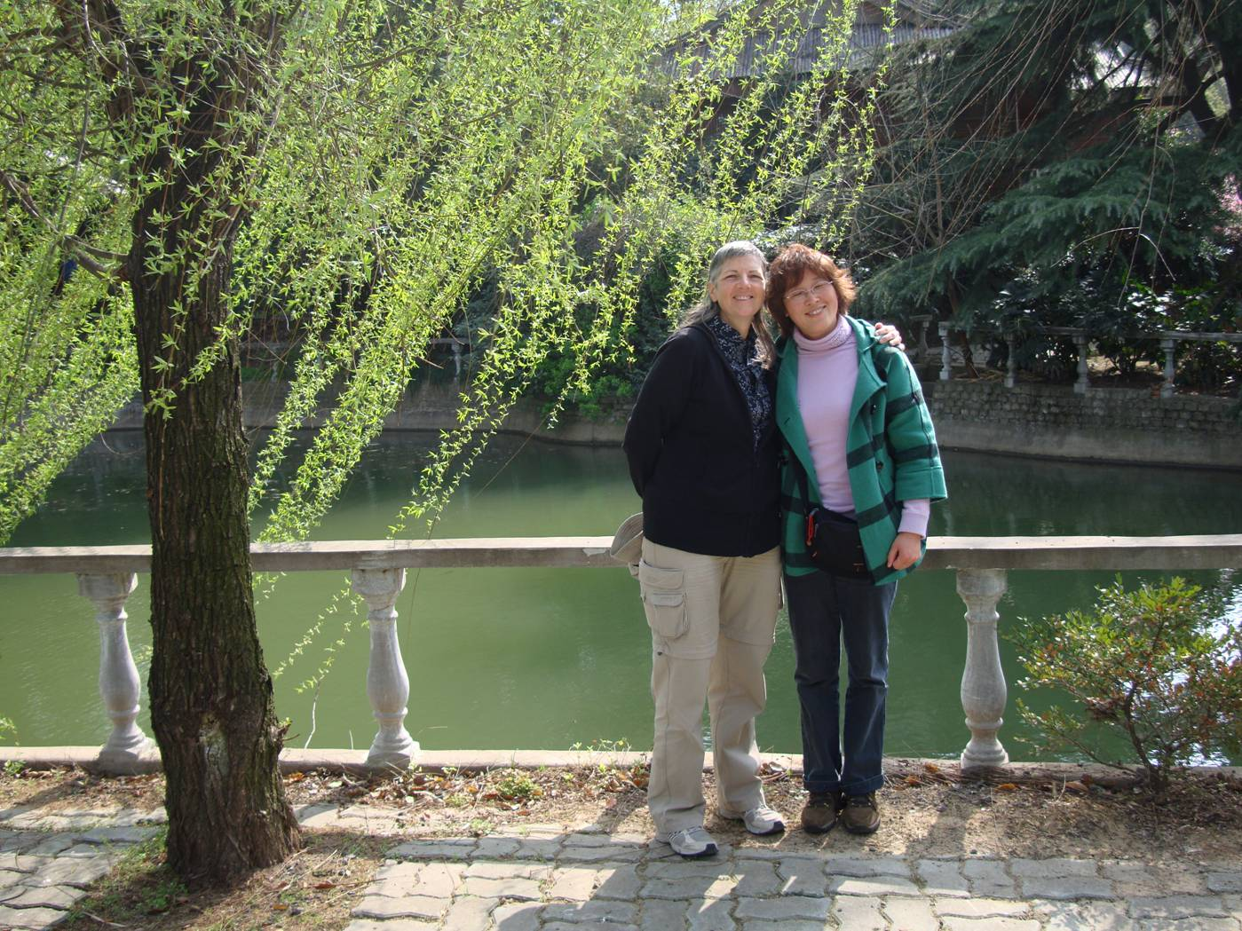 Picture:  Ruth with George's mother under a willow tree.  Yang Shan, Wuxi, China