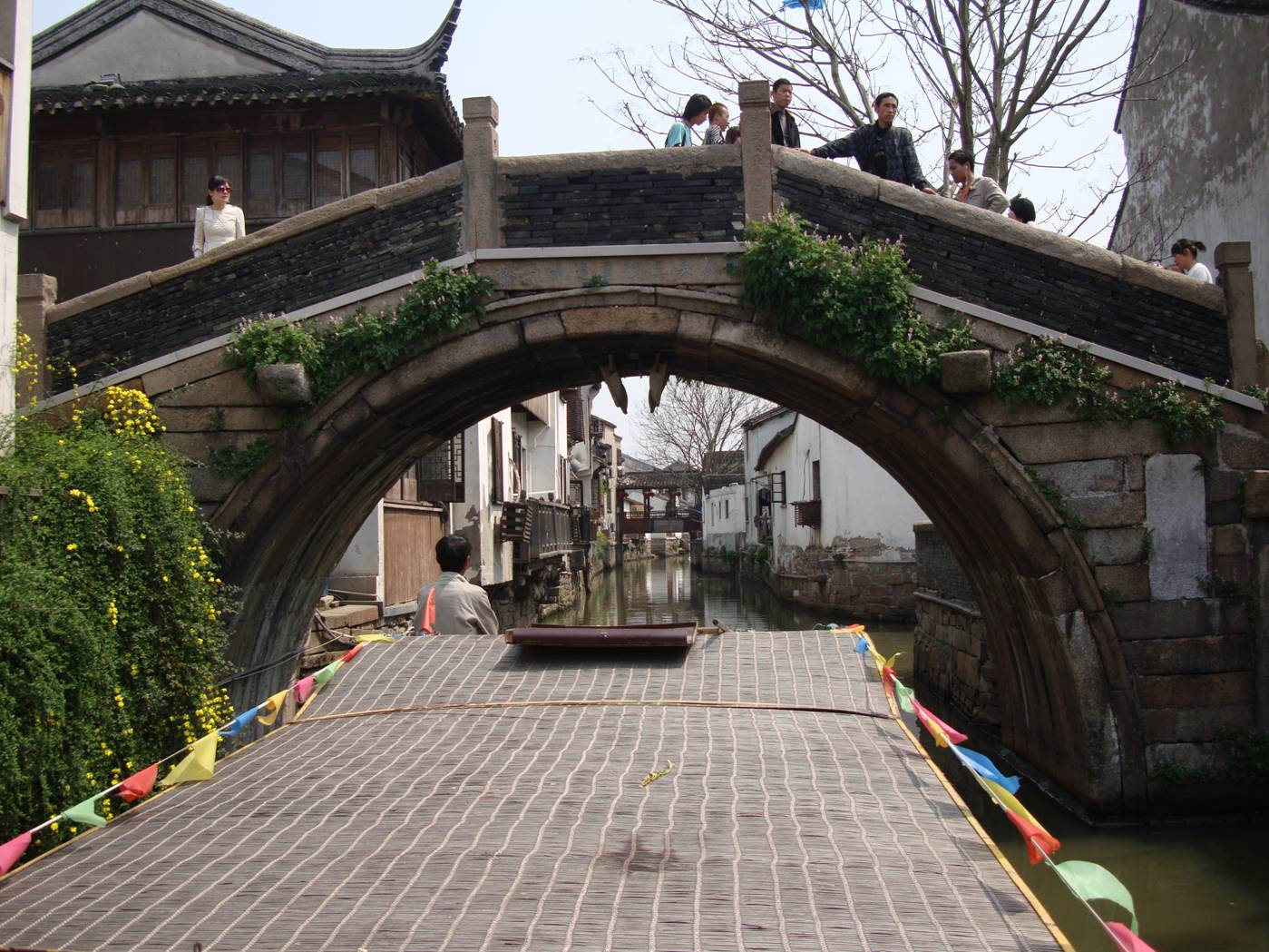 Picture:  Our canal tour boat goes under an old pedestrian bridge.  Suzhou, China