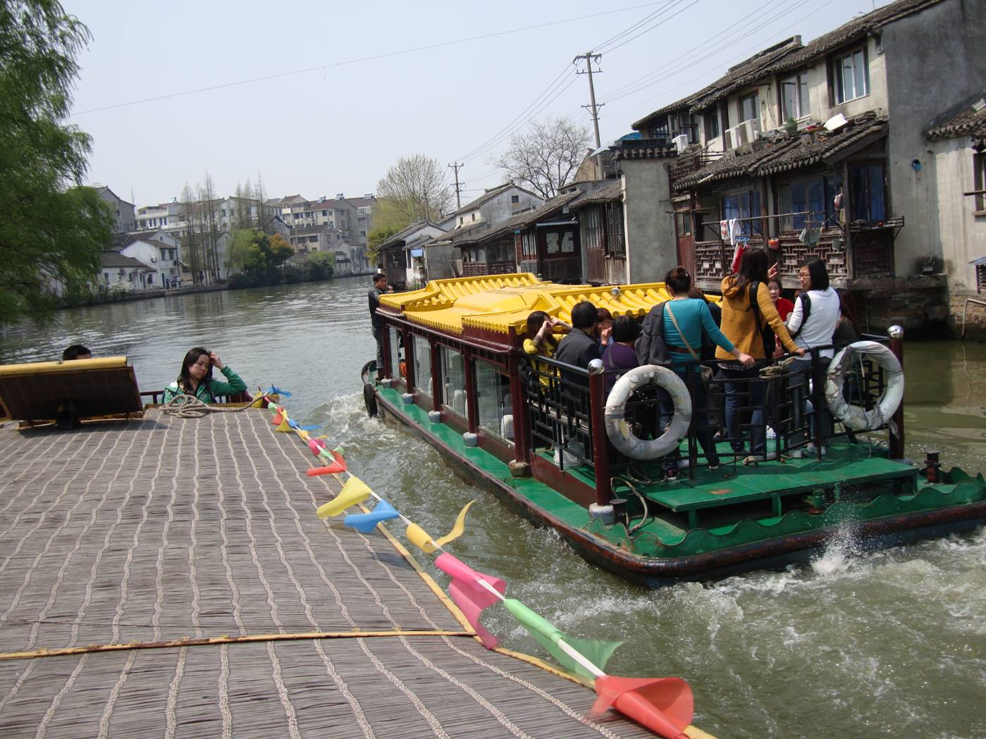 Picture:  We pass another tour boat on the canal.  Suzhou, China