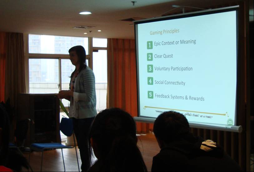 Picture:  Talis describes the principles of computer games that can be applied to volunteering.  Wuxi, China