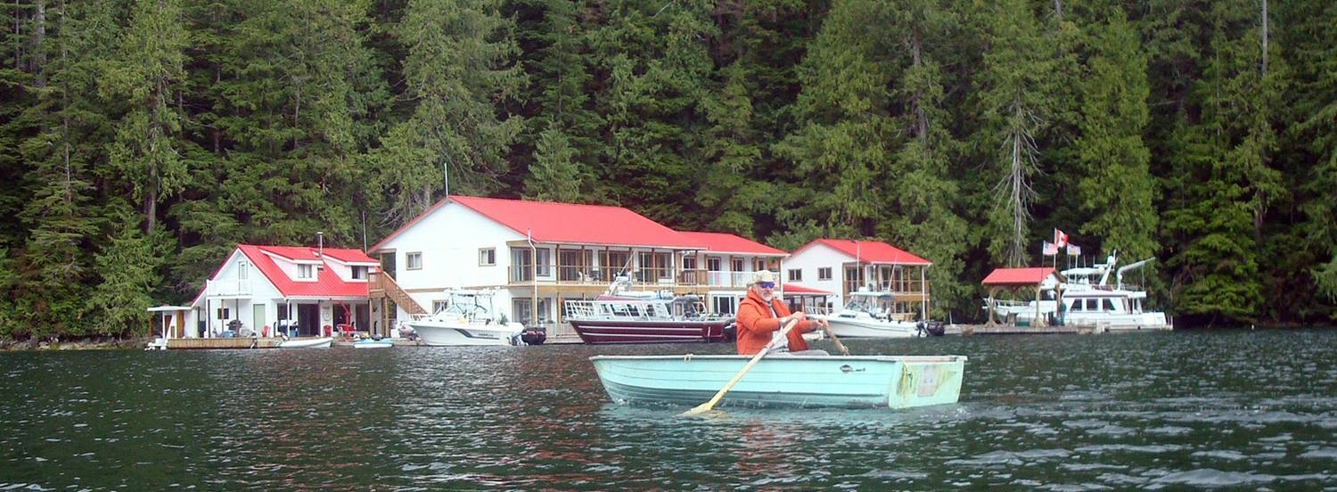 picture:  David Scott in a rowboat in front of Nootka Sound Lodge, Nootka Sound, B.C., Canada