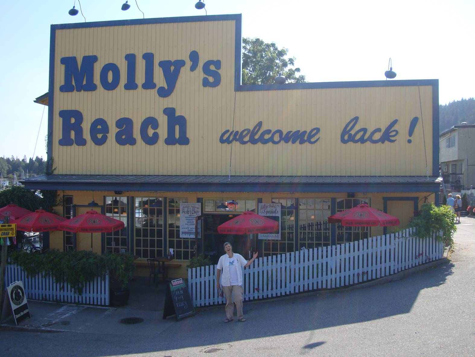 "picture:  Ruth mugs in  front of Molly's Reach, famous as the set for the Canadian TV series, ""Beachcombers""."
