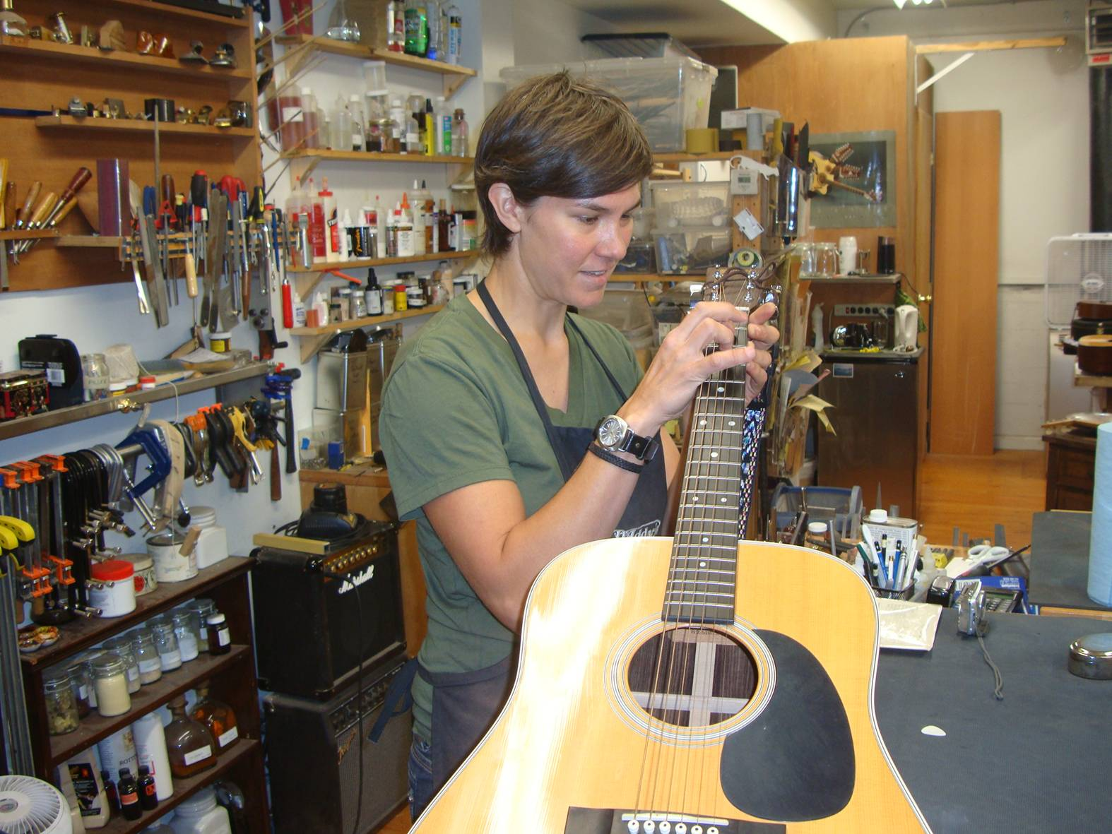 picture:  Nicol Alosinac, luthier, inspects my guitar.  Vancouver, B.C.