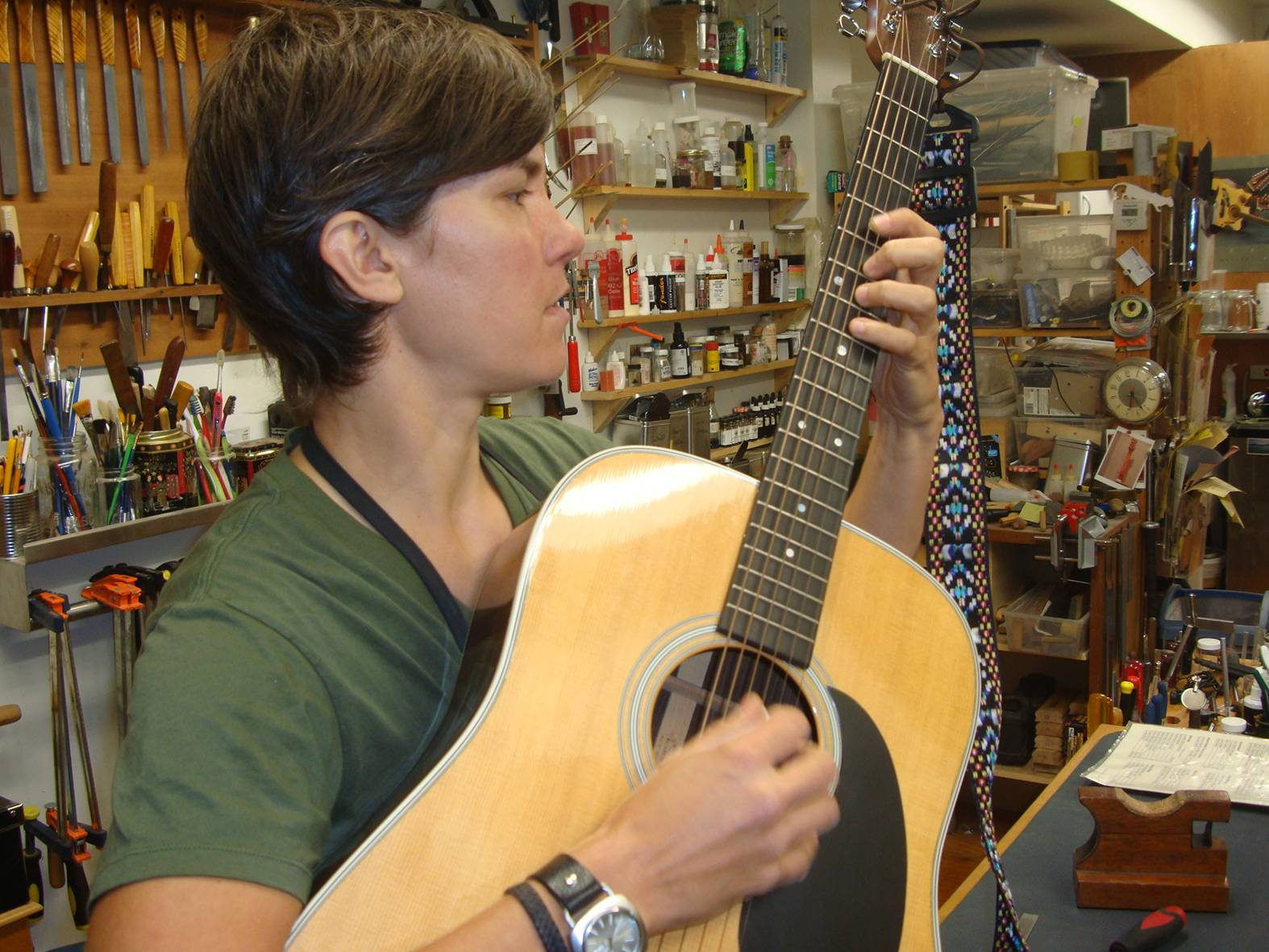 picture:  Nicole Alosinac tests out my Martin D28, which she has significantly improved.  Vancouver, B.C.