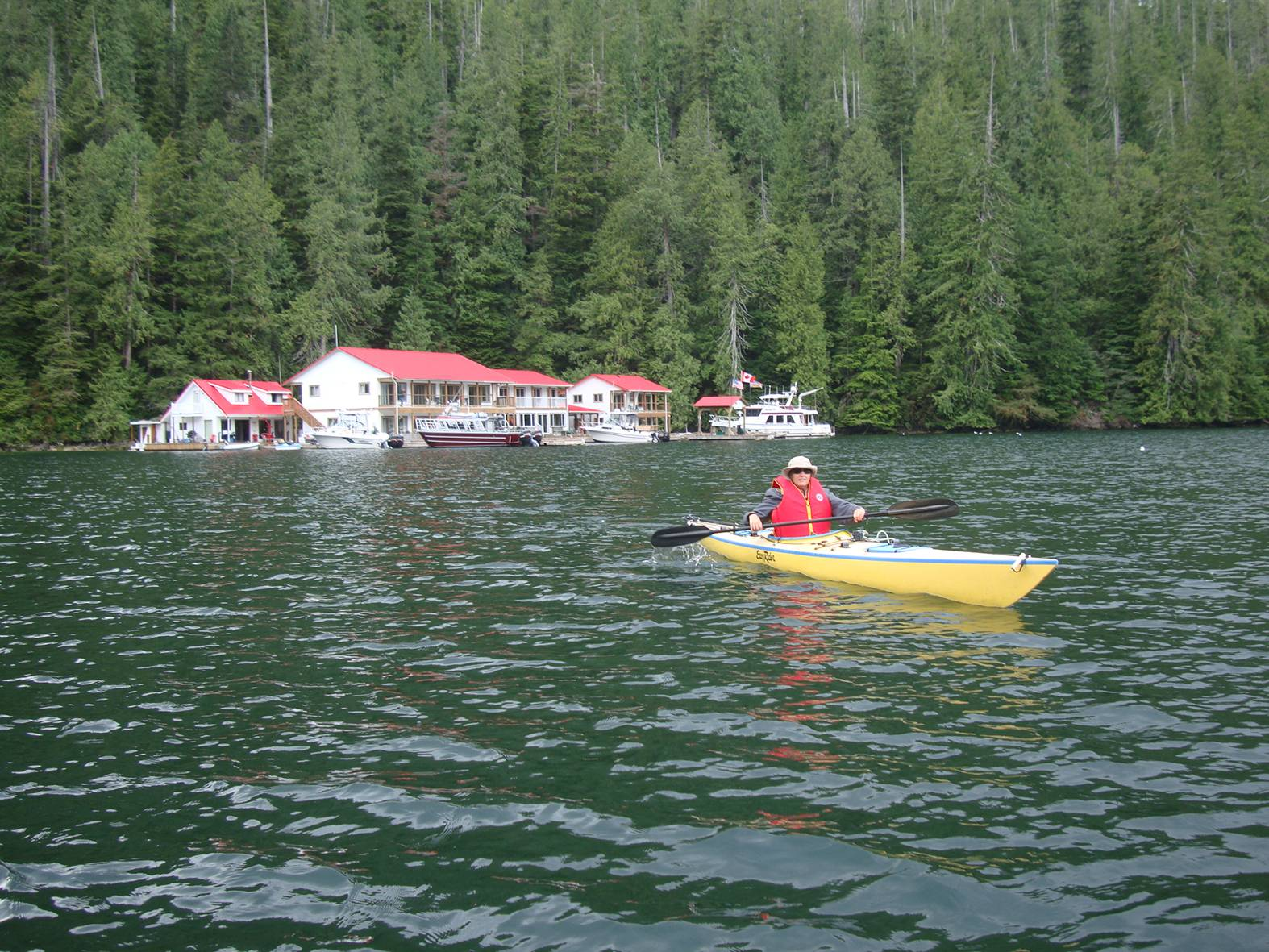 picture:  Nootka Sound Resort with Ruth in the foreground enjoying a kayak.