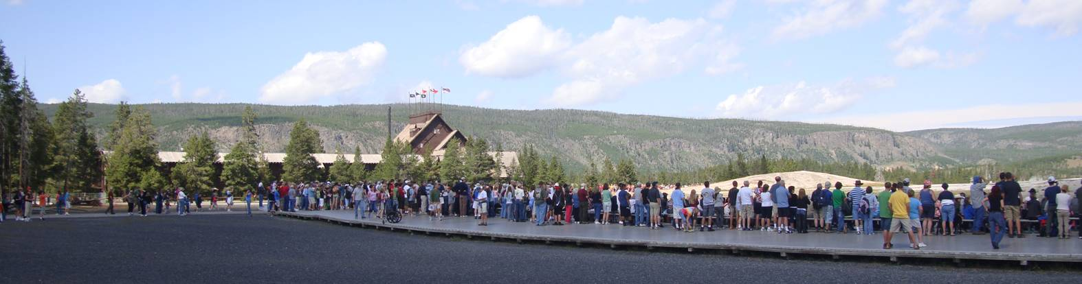 picture: a huge crowd gathers to watch Old Faithful blow water into the air.  Yellowstone Park.