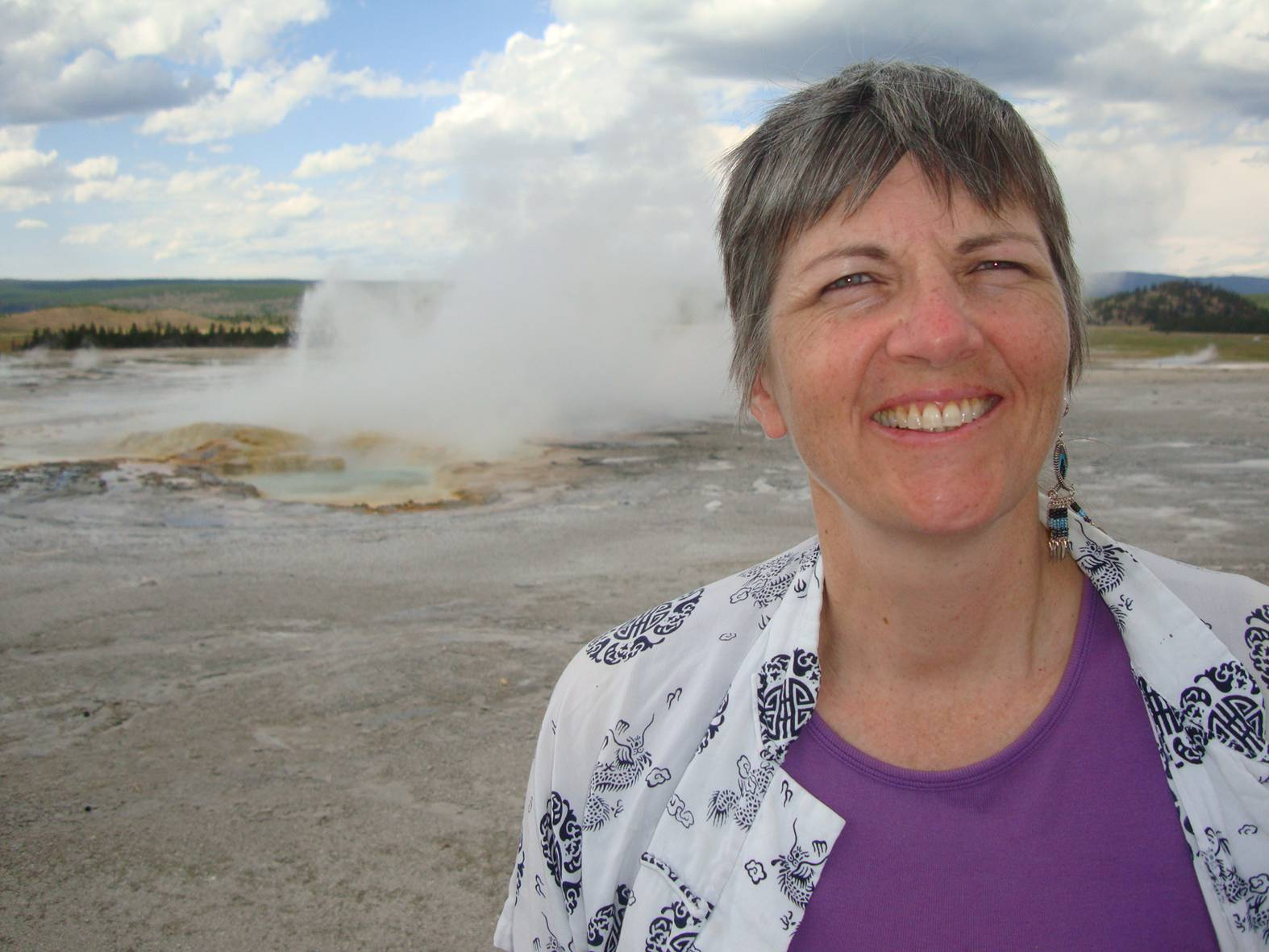 picture:  Ruth with a hot pool behind her.  Yellowstone Park