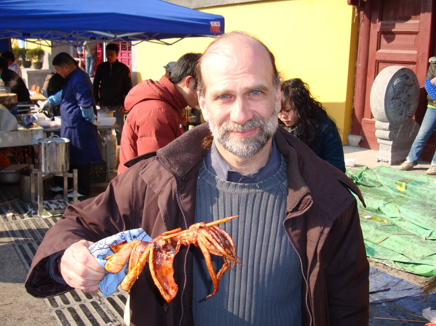 Bruce Schneier enjoys a tentacle at the Nanchan Temple market.  Downtown Wuxi,  China