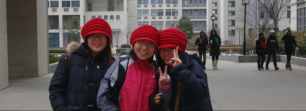 Picture:  I saw these three girls in identical hats and just had to take their picture.  Jiangnan University, Wuxi, China
