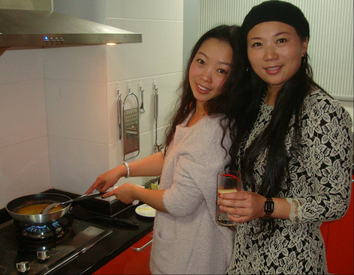 Picture:  Michelle and Kathy take care of the gravy.  Christmas in Nantong, China