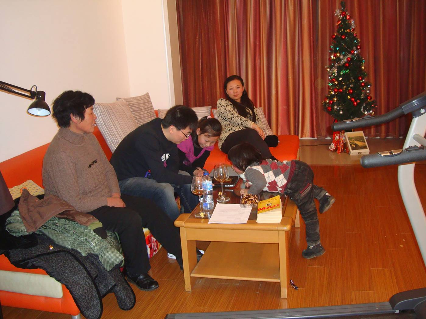 Picture:  It was a small tree, and a small pile of presents compared to family Christmases in my past.  But the warmth and family feeling was wonderful.  Christmas in Nantong, China