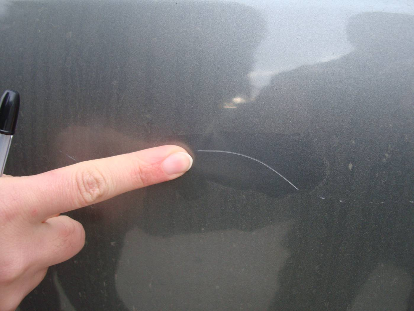 Picture:  The agent points out a scratch on the Honda rental car.  Wuxi, China