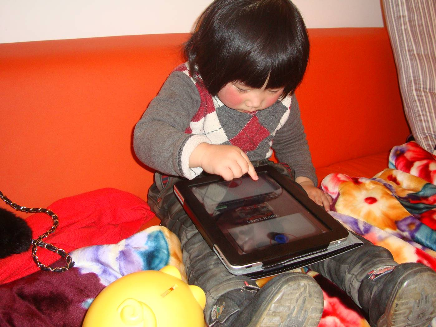 Picture:  The China doll investigates a touch screen.  A bit later it was a thump screen, but no harm was done.  Christmas in Nantong, China