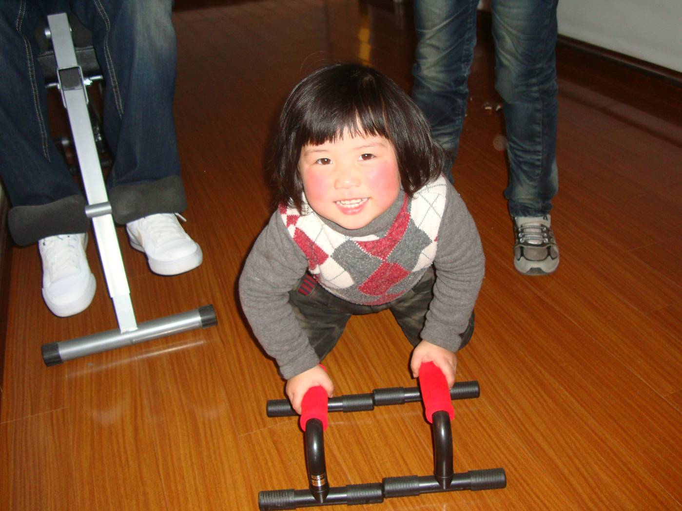 Picture:  A China doll investigates Rob's fitness equipment.  Christmas in Nantong, China