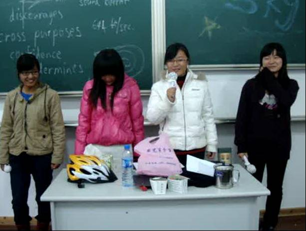 Picture:  My students in performance of a song.  Click the picture to play the video.  Jiangnan University, Wuxi, China