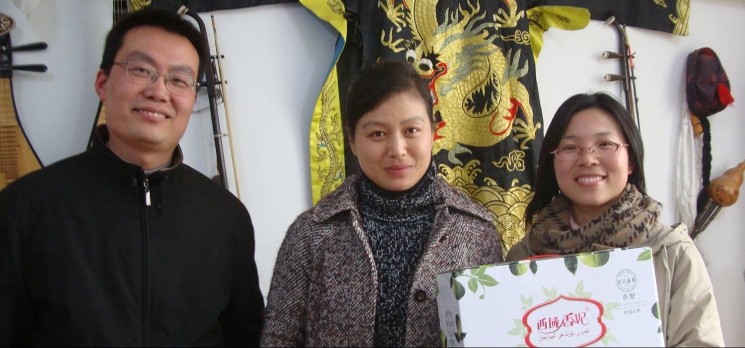 Picture:  Left to right - Deputy Director Yao Xin, Director Zhong Fang, and office assistant Shirley Li 孙梦黎 with an introductory gift of fruit.  Jiangnan University, Wuxi, China