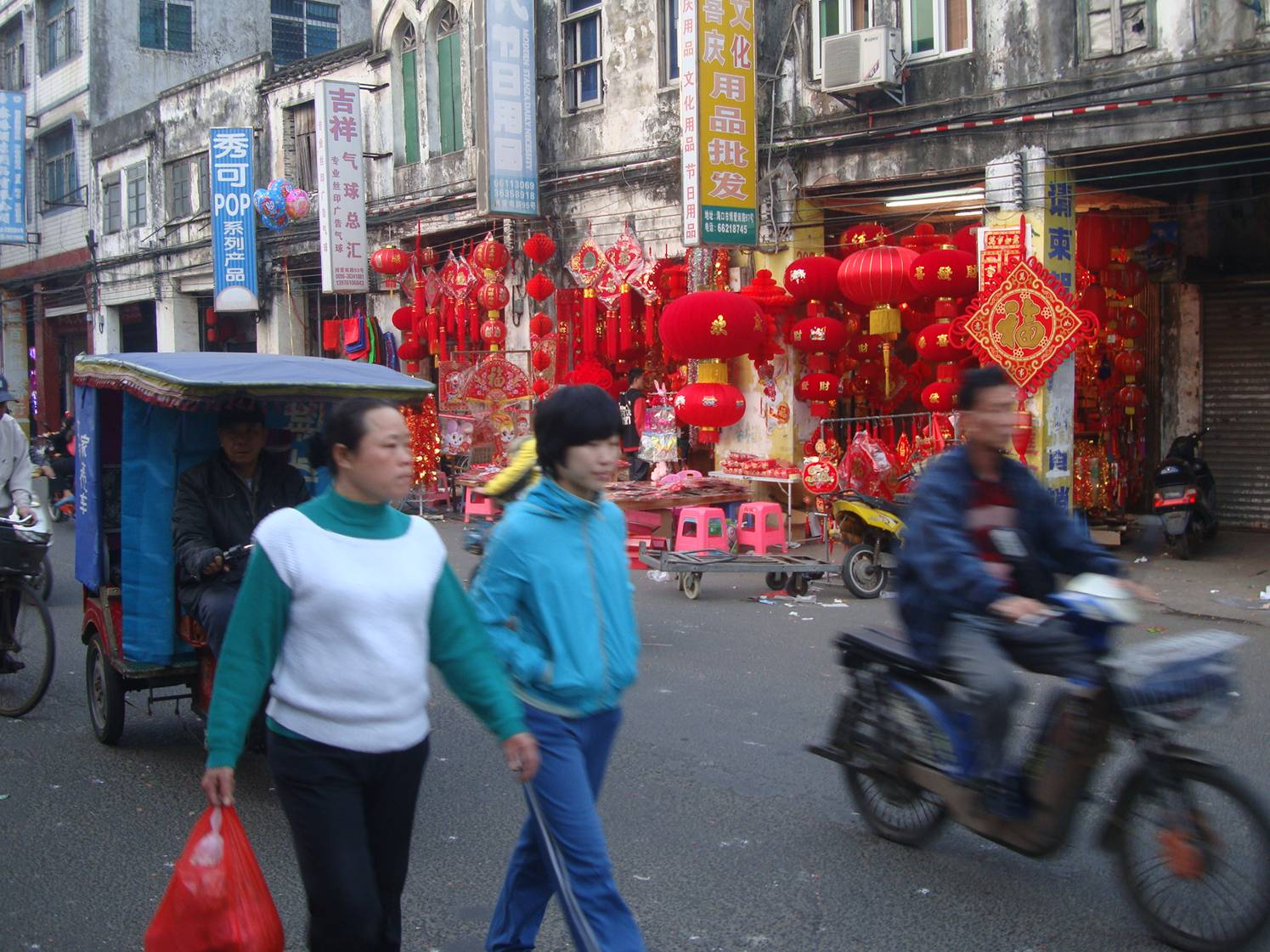 Picture:  Colourful shops sprang up all over Haikou, selling decorations for the Chinese New Year festivities.  Hainan Island, China