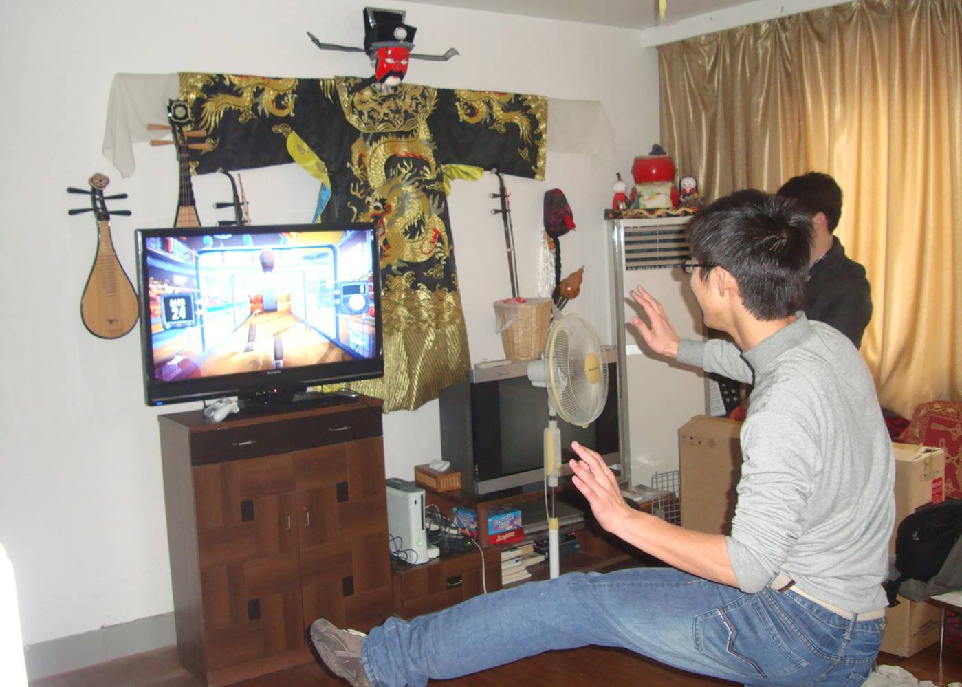 Picture:  A student tries out one of the Kinect games.  Jiangnan University, Wuxi, China