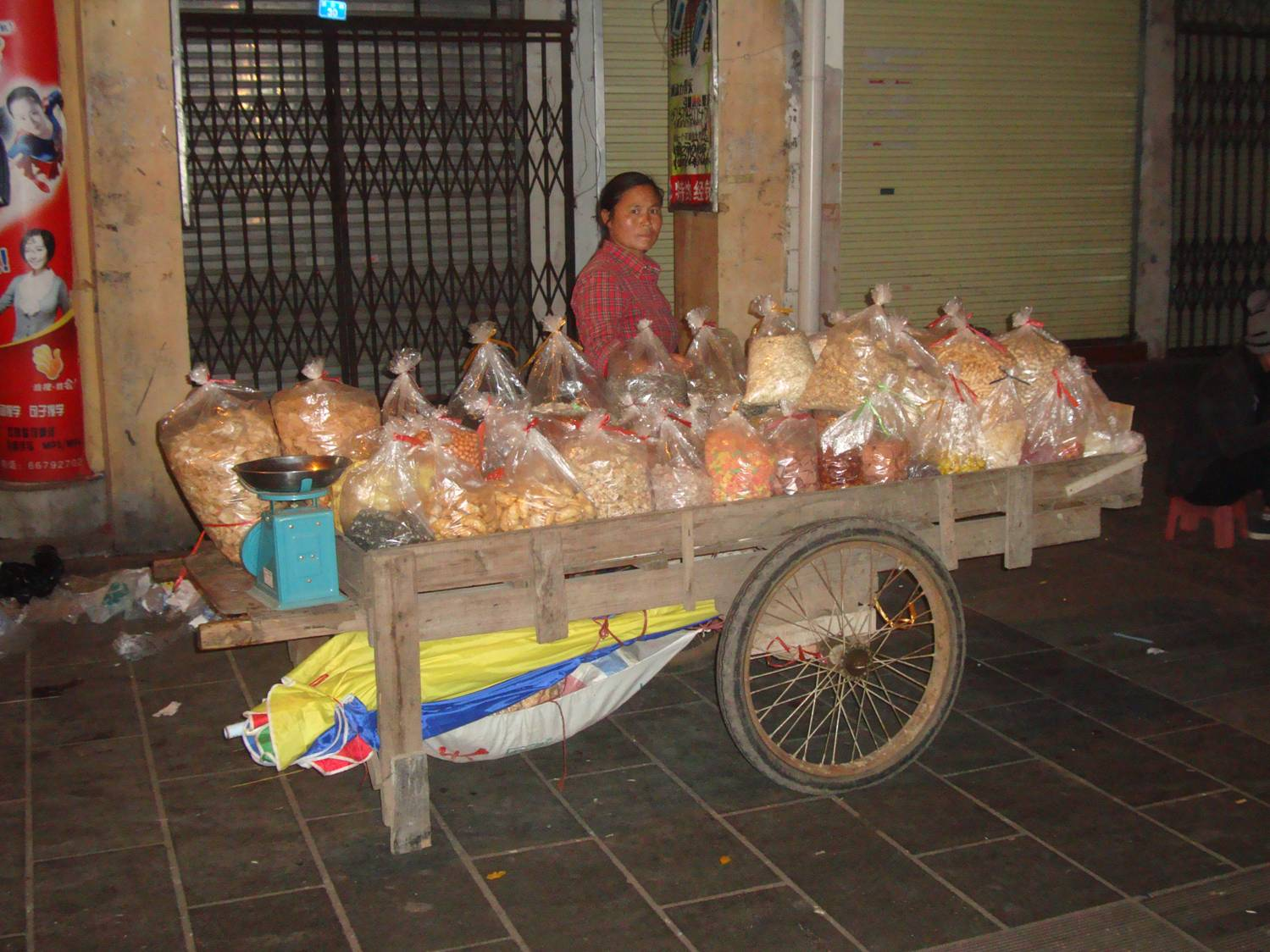 Picture:  A home made cart and a supply of food items and you're in business in Haikou, Hainan Island, China.