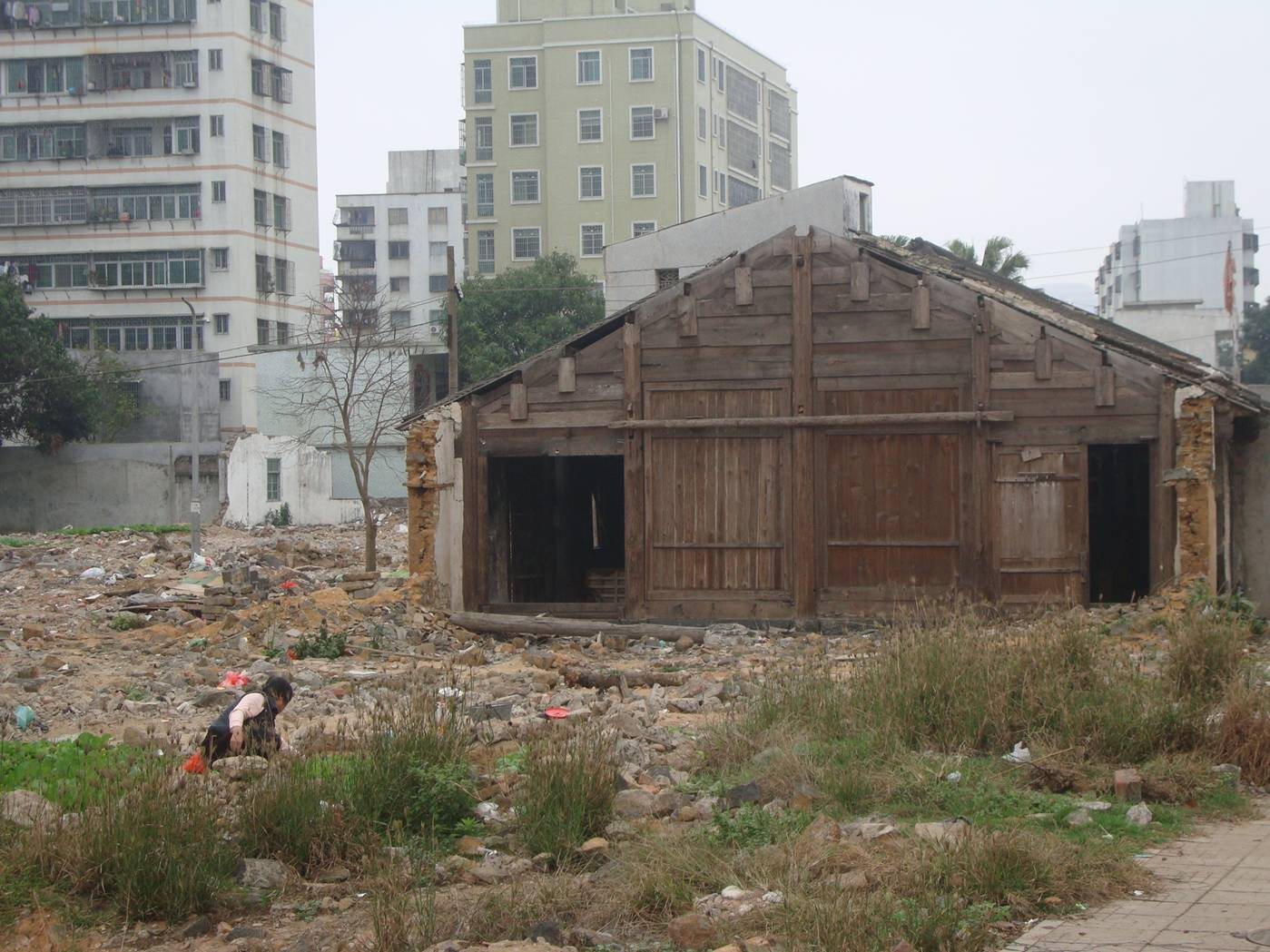 Picture: The old farm building, a sad remnant of an agricultural lifestyle now lost to and surrounded by urbanization.  Haikou, Hainan Island, China