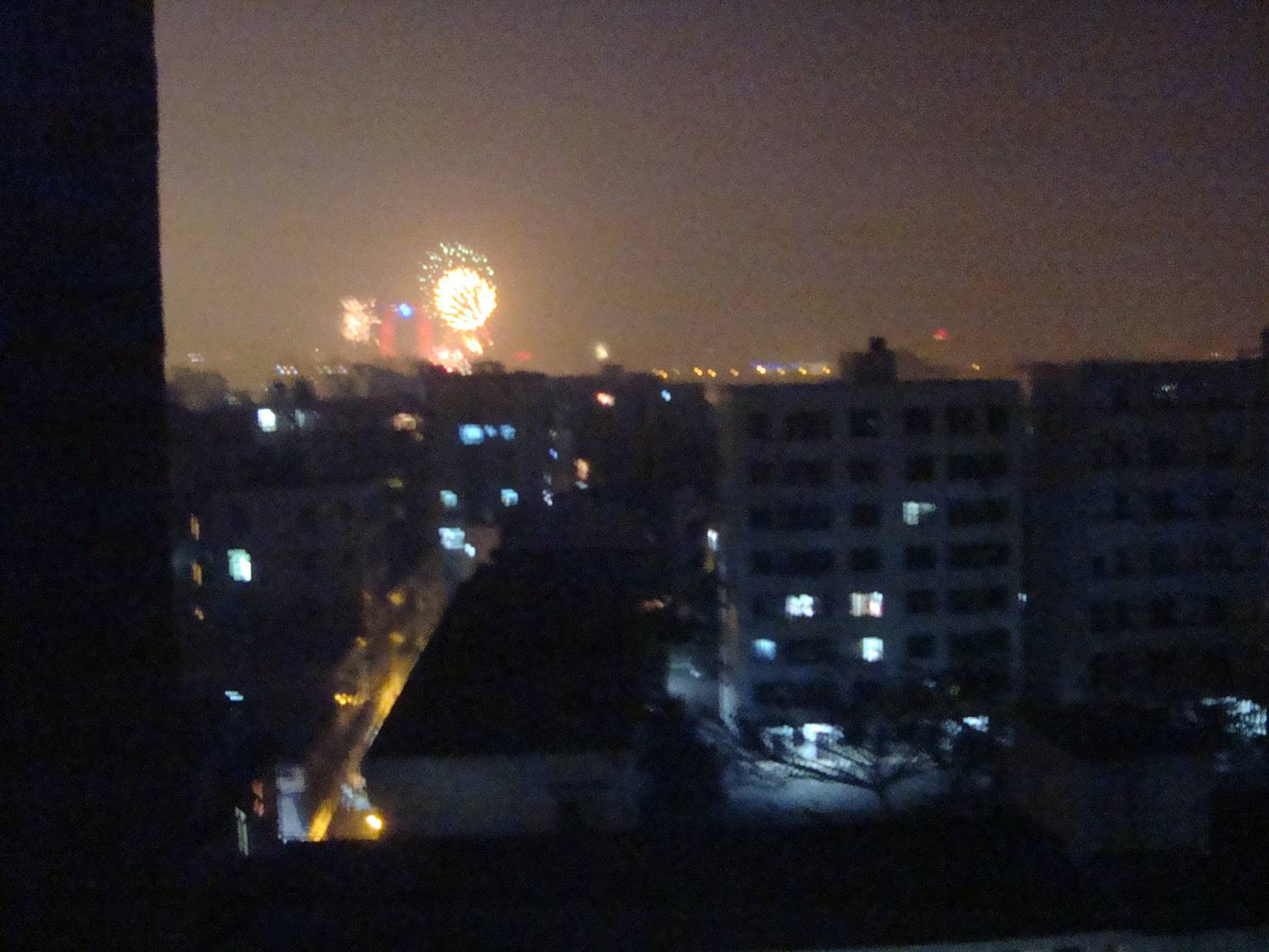 Picture:  The view from our hotel room.  The fireworks were distant, but the sound wasn't.  Click the picture for a short video clip.  Haikou, Hainan Island, China