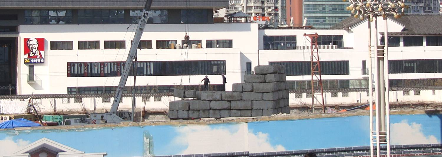 Picture:  Big concrete blocks at a constructions site downtown Wuxi, China