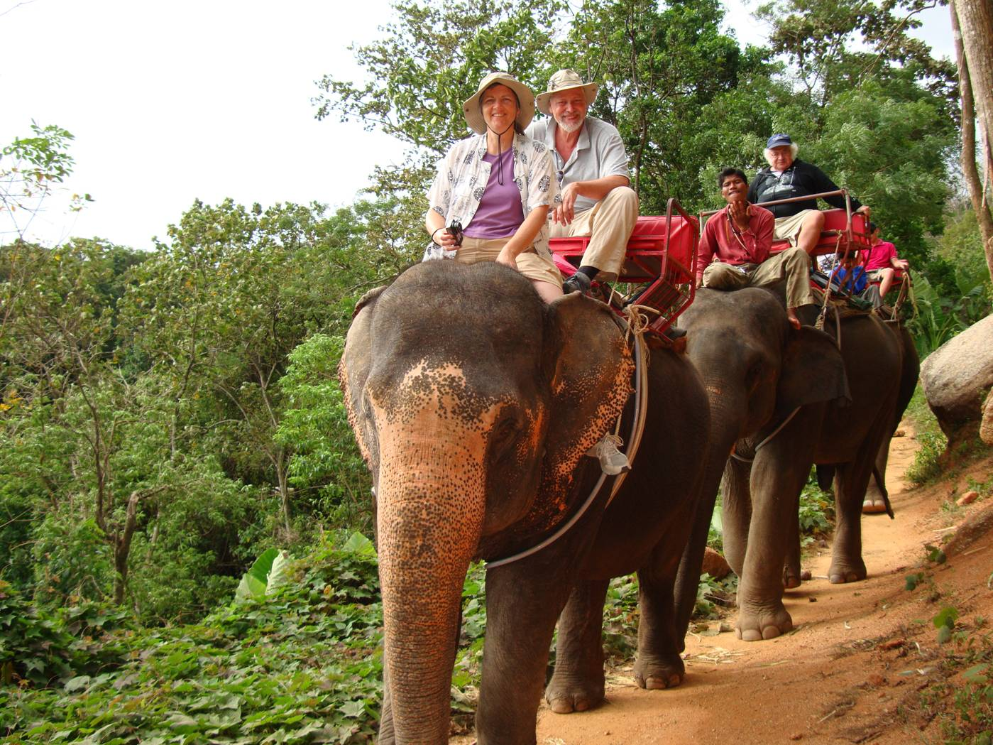 Picture:  Ruth at the wheel of several tons of elephant.  David is just a passenger.  Phuket Island, Thailand