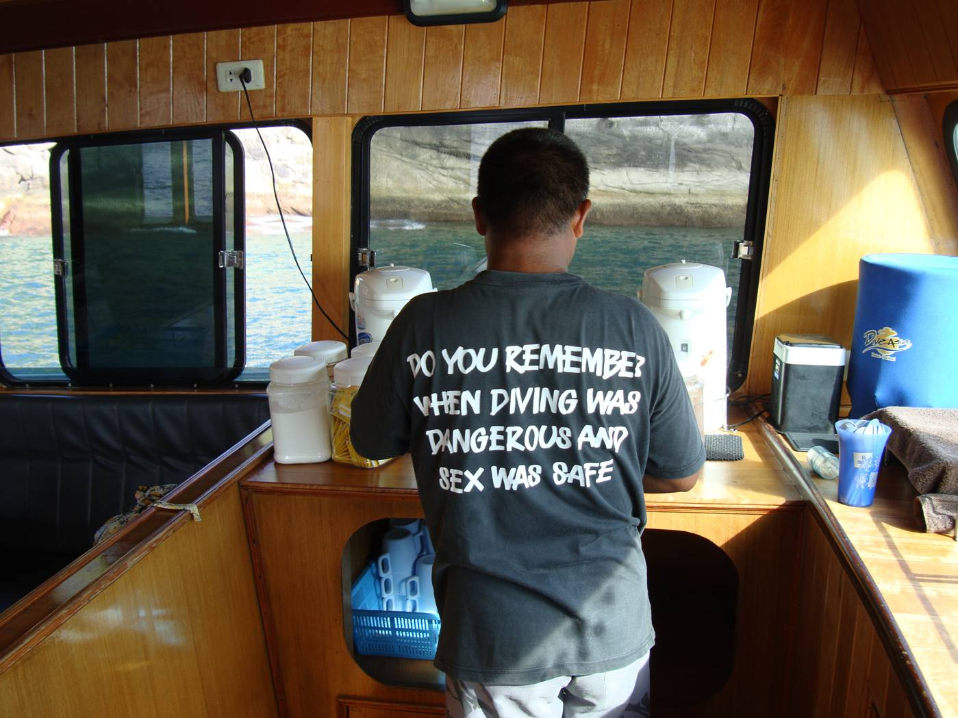 Picture:  Dive Asia crewmember in a very ironic T-shirt.  Dive Asia, Phuket Island, Thailand