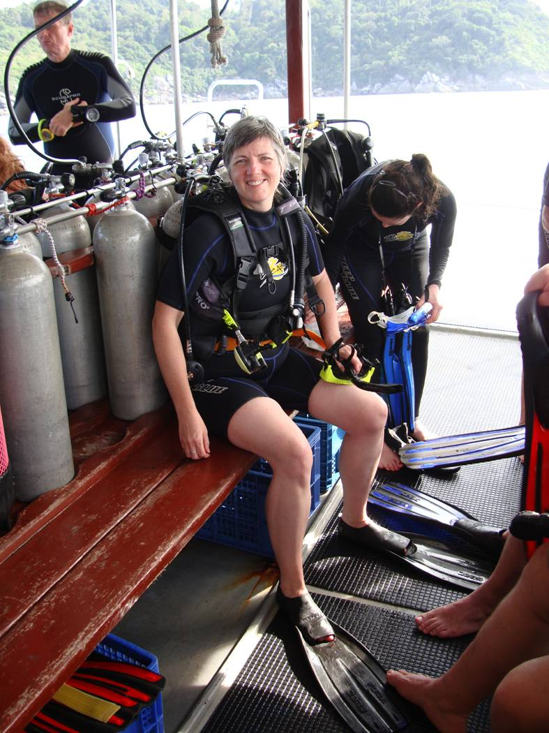 Picture:  Ruth back on board getting ready for hier third dive.  Or maybe this was before her first dive.  Dive Asia, Phuket Island, Thailand.