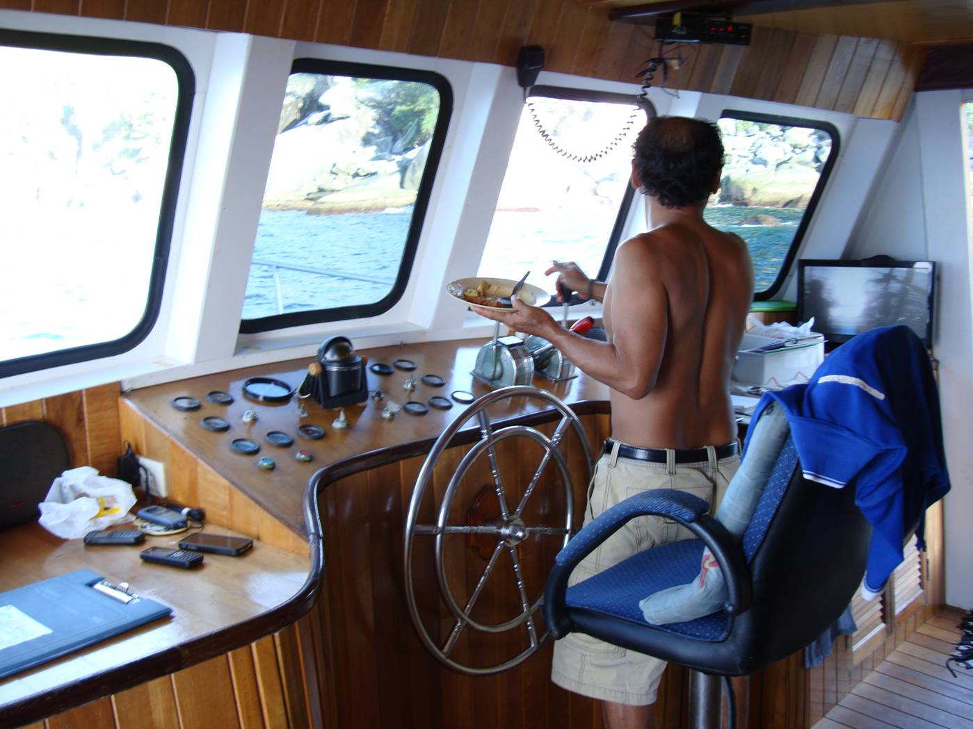 Picture:  The captain enjoys his lunch between dive spots.  Dive Asia out of Phuket Island, Thailand