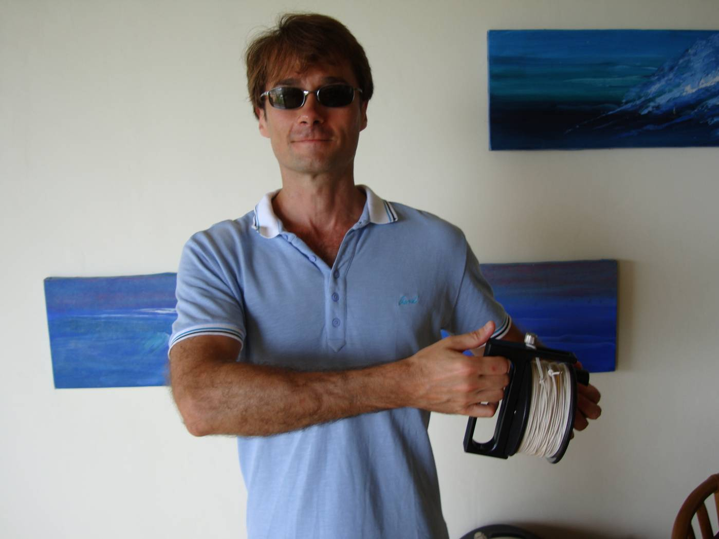 Picture:  Doug with his freshly washed and dried reel of diver surveyor line.  Phuket Island, Thailand