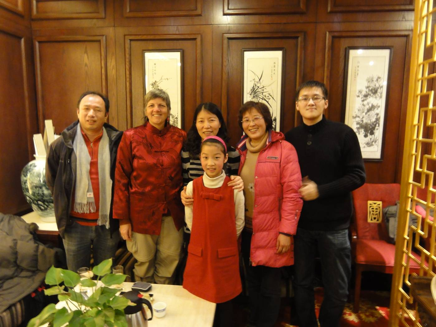 Picture:  George with his mother, aunt, uncle and cousin.  Wuxi, China