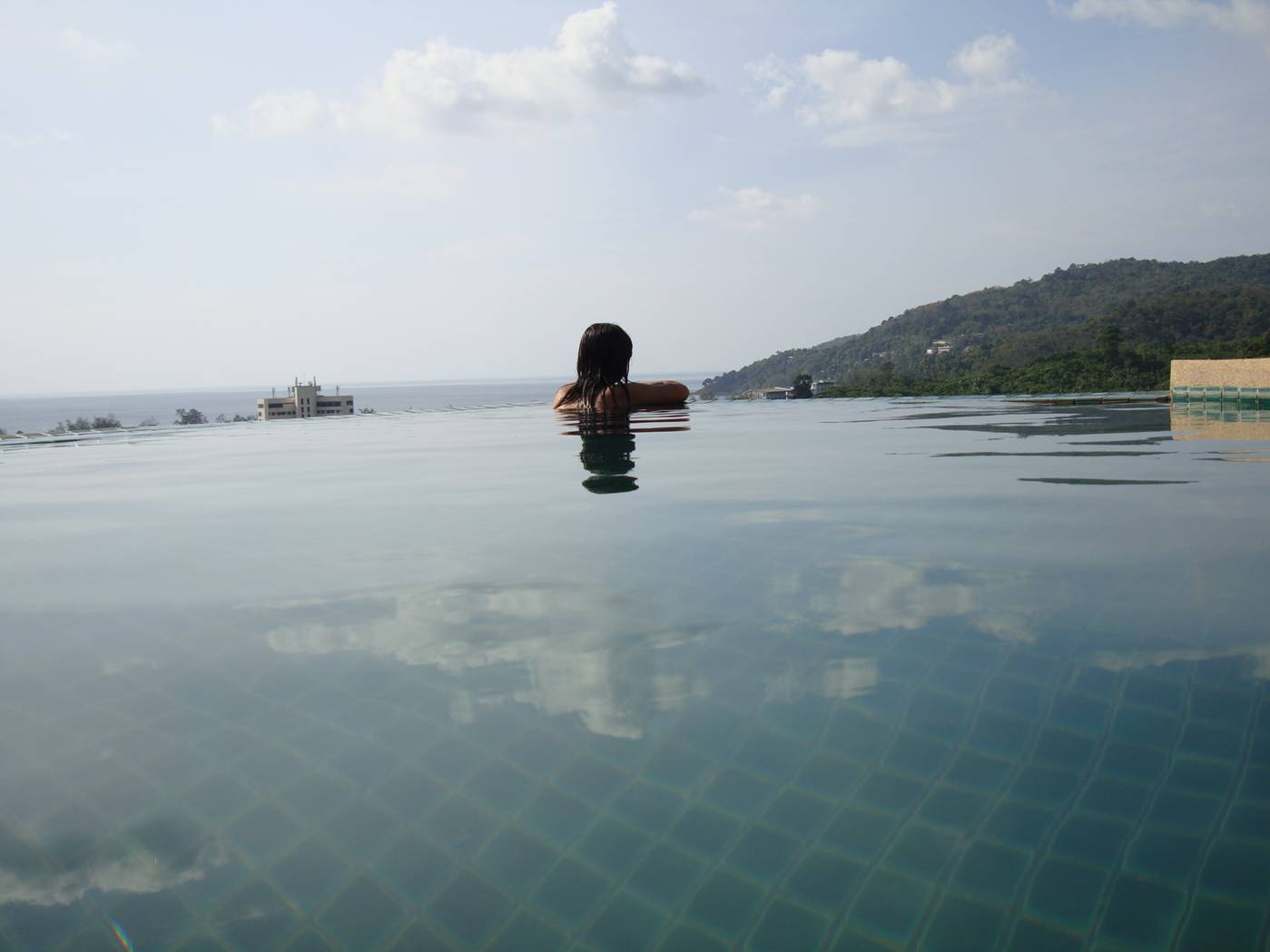 Picture:  Naam contemplates infinity in the infinity pool on the roof of the villa.  Karon Beach, Phuket Island, Thailand