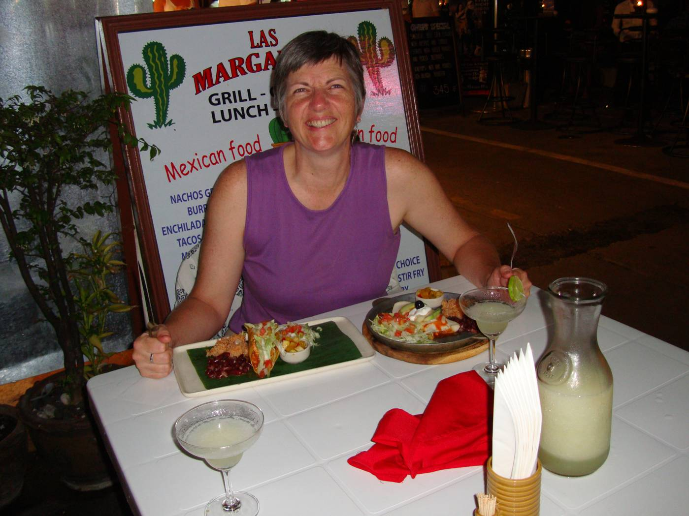 Picture:  Ruth enjoys sharing our last pitcher of margaritas.  Phuket Island, Thailand