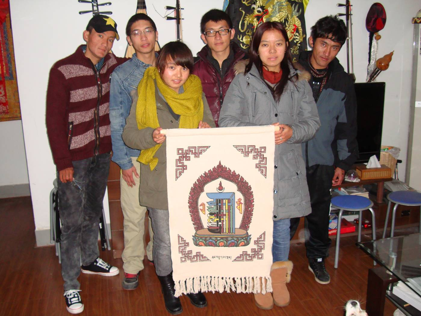 Picture:  Our Tibetan students presented us with a wall hanging.  Jiangnan University, Wuxi, China