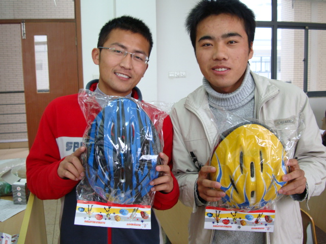 It feels good to sell something that is good for students.  Two of the first 50 students to buy a bike helmet,  Jiangnan University,  Wuxi,  China