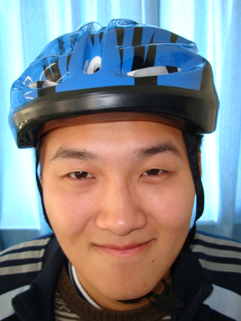 George says he has his own helmet.  Now maybe he'll wear it.  One of the first 50 students to buy a bike helmet,  Jiangnan University,  Wuxi,  China
