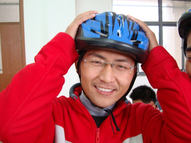 Picture:  One of the early supporters of my bike helmet campaign.  Now we're showing signs of progress at last.  Jiangnan University, Wuxi, China
