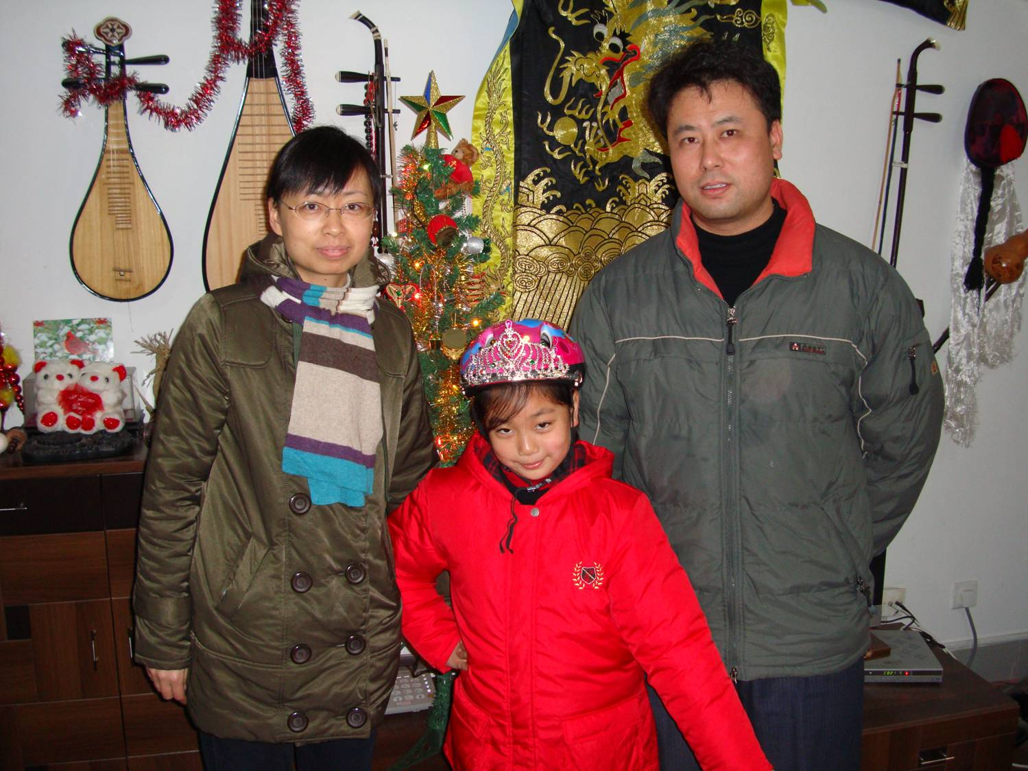Lucy,  daughter Jenny, and husband have come to get a helmet for Jenny.  Jiangnan University,  Wuxi,  China
