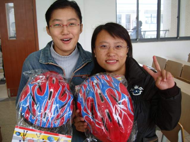 The prediction was that boys would buy helmets first,  but so far the girls are keeping up with them.  Two of the first 50 students to buy a bike helmet,  Jiangnan University,  Wuxi,  China