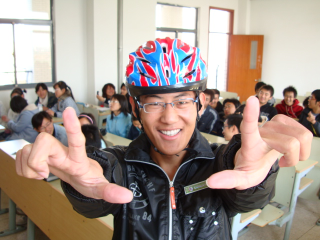 Sunshine.  A gleeful supporter of this initiative and one of the first 50 students to get a bike helmet,  Jiangnan University,  Wuxi,  China