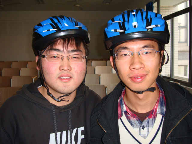 Two of the first 50 students to buy a bike helmet,  Jiangnan University,  Wuxi,  China