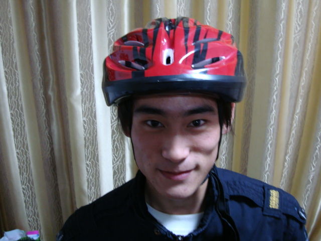 Wang Rulong in his new helmet.  Looking like a movie star.  One of the first 50 students to wear a bike helmet,  Jiangnan University,  Wuxi,  China