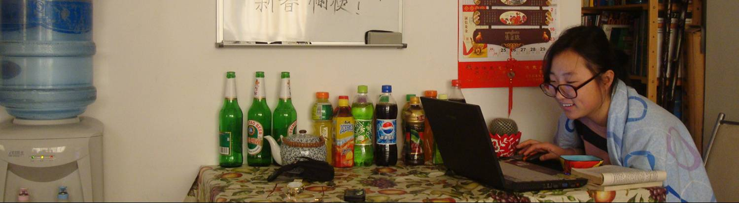 "Our friend Panda at work.  The bottles are left over from our"" Chinese corner"" party the night before.  Jiangnan University, Wuxi, China"