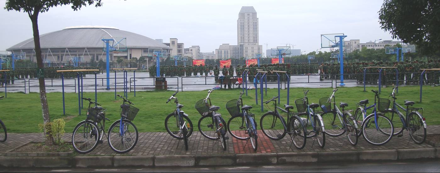 Picture:  The China we know.  A row of bicycles, a basketball court full of young soldiers in training, and the gymnasium and library in the distance.  Says it all.  Jiangnan University, Wuxi, China