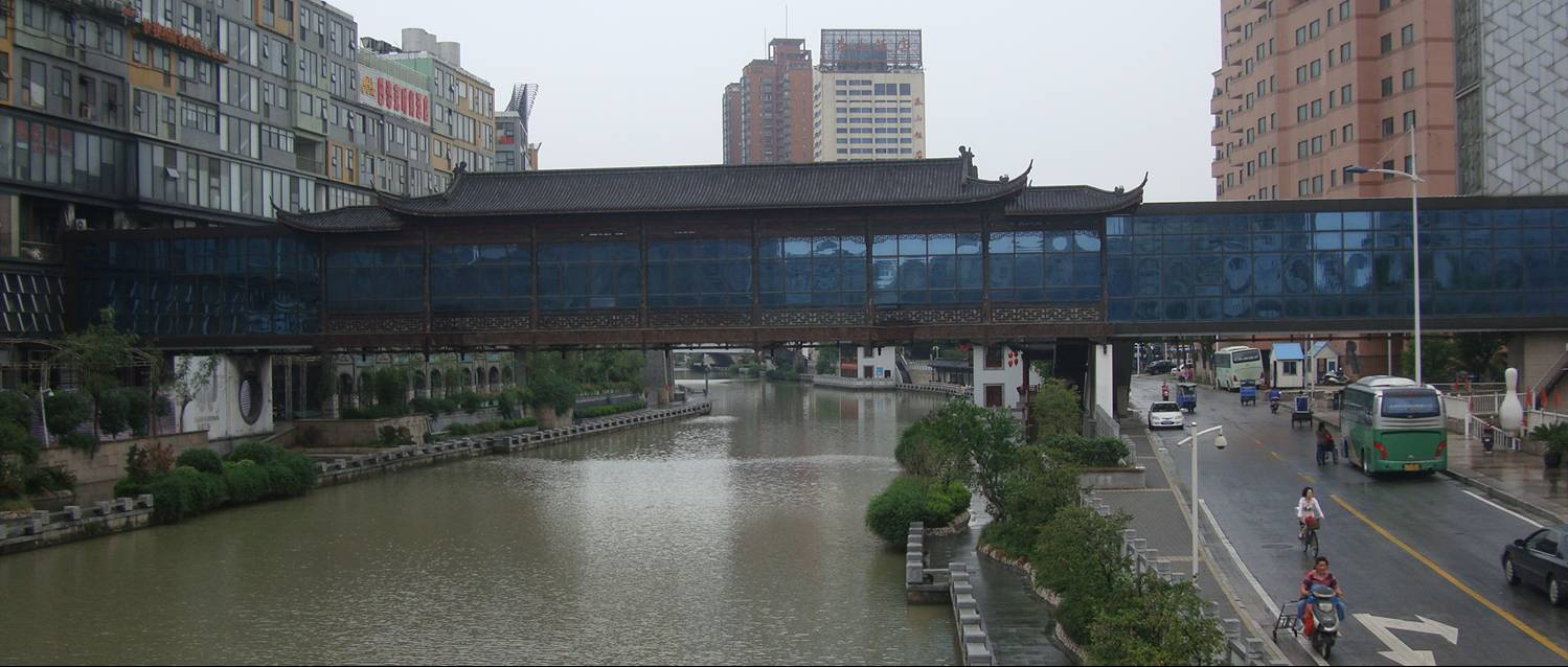 Picture:  The surprising covered pedestrian bridge over the canal in downtown Wuxi, China