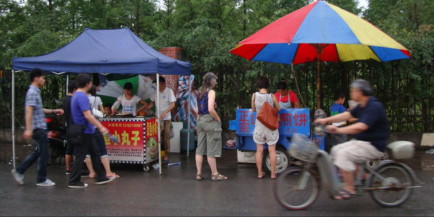 Picture:  The street food stalls on Shi Tang Jie.  Wuxi, China
