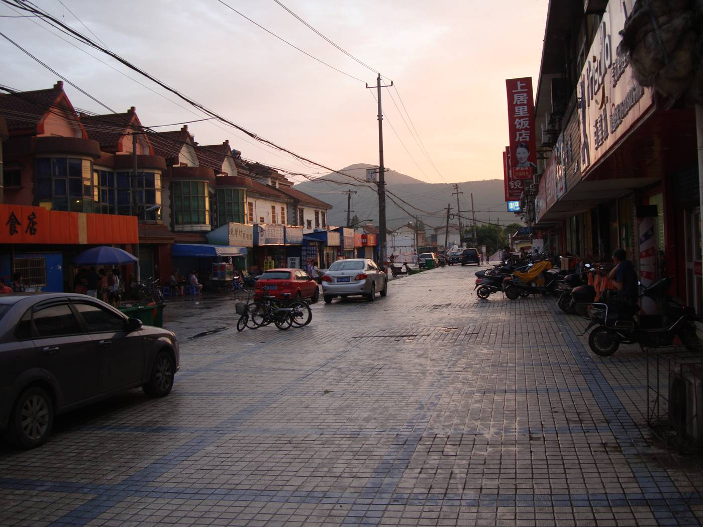 Picture:  The main street of Shi Tang Cun, the little village near our campus, the next victim of urban renewal.  Wuxi, China