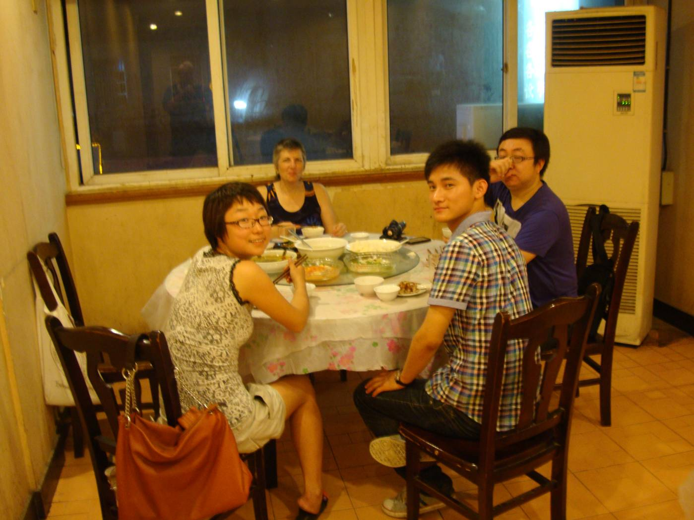 "Picture:  Panda, Devan, Ruth and Jin Bo at our table in ""the Duck"" restaurang in Shi Tang Cun"